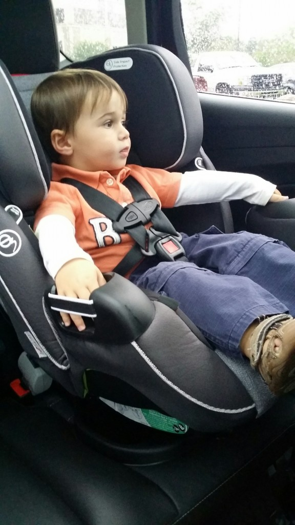 Totally relaxed in his car seat