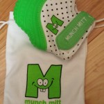 Sooth your teething baby with the Munch Mitt teething mitten.