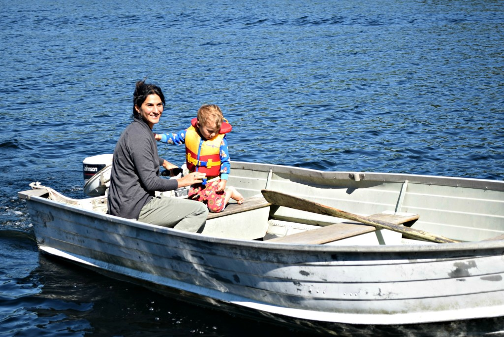 me driving the boat with Nate at cottage