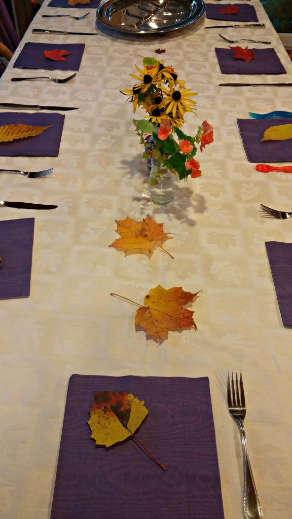 Thanksgiving table decorated with leaves